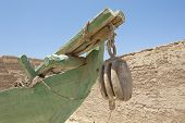 stock photo of pulley  - Closeup detail of old wooden block and tackle pulley on bow of traditional egyptian fishing felluca boat - JPG