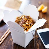 picture of lo mein  - chinese take out with smart phone on table and menu - JPG