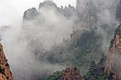 foto of shan  - Photo of spectacular rocks and peaks of Huang Shan Mountains China in the mist - JPG