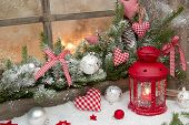 image of wood craft  - Red rustic christmas decoration on window sill with red checked hearts in country style - JPG