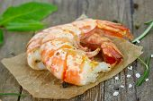 picture of tiger prawn  - grilled prawns with rosemary close up on wooden table - JPG