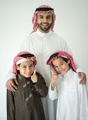 picture of muslim kids  - Arabic young father posing with kids - JPG