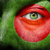 picture of bangladesh  - Flag painted on face with green eye to show Bangladesh support - JPG