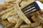 image of parsnips  - Cut roasted parsnips or potatoes with herbs - JPG