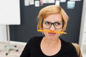 Macro Woman Putting Pencil Between Nose And Lip poster
