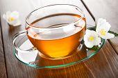foto of jasmine  - Jasmine tea with jasmine herb flower on table background - JPG