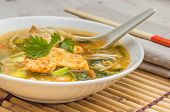 stock photo of vegetable soup  - Asian chicken soup with vegetables and cilantro  - JPG