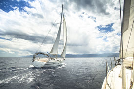 pic of sailing vessels  - Sailing yacht on the race in a stormy sea - JPG