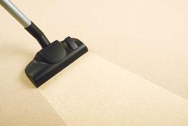 image of sweeper  - Vacuum Cleaner sweeping Brand New Carpet - JPG