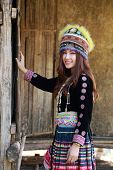 pic of hmong  - Traditionally dressed Mhong hill tribe woman in the wooden cottage - JPG