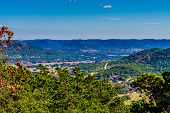 Постер, плакат: Wide view of a big valley from high on a hill in the famous Texas hill country