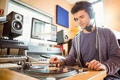 stock photo of recording studio  - Portrait of an university student with a turn table in the studio of a radio - JPG