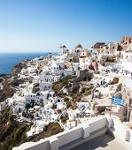stock photo of windmills  - Oia village Santorini in Greece view with windmills - JPG