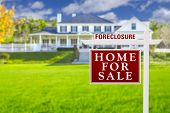 picture of yard sale  - Foreclosure Home For Sale Real Estate Sign in Front of Beautiful Majestic House - JPG