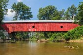 stock photo of yesteryear  - The Oakalla Covered Bridge crosses Big Walnut Creek in rural Putnam County Indiana - JPG