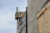 foto of oddities  - Abandoned factory exterior and crumbling wall - JPG