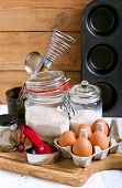 stock photo of cake-mixer  - Baking cake ingredients and cooking tools on wooden surface - JPG