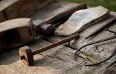 stock photo of woodcarving  - close-up photo of historical carpentry tools on a rough wooden table ** Note: Shallow depth of field - JPG