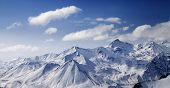 pic of snowy hill  - Snowy winter mountains in sun day - JPG