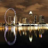 picture of singapore night  - Singapore skyline at night with urban buildings - JPG