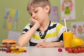 pic of school lunch  - Healthy and unhealthy lunch on school desk - JPG