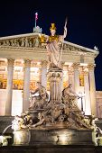 stock photo of goddess  - Night view of Parliament building in Vienna Austria - JPG