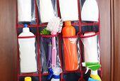 picture of detergent  - Different detergents in hanging bag wooden door - JPG