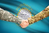 stock photo of south american flag  - Soldiers handshake and US state flag  - JPG