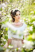 image of japan girl  - Portrait of beautiful girl posing outdoor with flowers of the cherry trees in blossom during a bright spring day - JPG