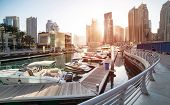 picture of emirates  - Panoramic view with modern skyscrapers and water pier of Dubai Marina at sunset - JPG