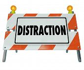 stock photo of dangerous situation  - Distraction word on a road construction barrier or sign to illustrate dangerous inattentive driving or hazardous situation - JPG