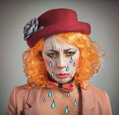 pic of clown face  - Theatrical sad and depressed girl clown crying - JPG