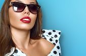 image of sun-tanned  - Portrait of young beautiful woman in sun glasses with perfect tanned skin - JPG