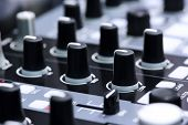 image of controller  - DJ mixer controller, fader and buttons of cool silver vinyl mixing console in nightclub, elective focus