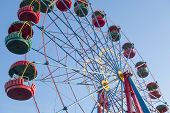 stock photo of ferris-wheel  - the Ferris wheel in the summer morning - JPG