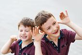 picture of mischief  - Little hyperactive caucasian brothers playing outdoor adhd - JPG