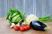 stock photo of scallion  - Fresh vegetables from the garden over wooden table - JPG