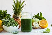 picture of kale  - Fresh kale fruit smoothie in a jar with ingredients - JPG