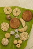 image of pooja  - Top View of Traditional Ceremonial Indian Sweets and Snacks from India - JPG