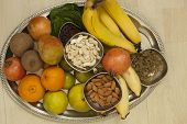 stock photo of dry fruit  - Top View of Fruits and dry fruits from thread ceremony function - JPG