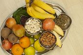 pic of dry fruit  - Top View of Fruits and dry fruits from thread ceremony function - JPG