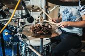 image of drum-kit  - Drumsticks and drums closeup and dried fruit on a plate - JPG