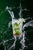 stock photo of freezing  - fresh mojito drink with liquid splash - JPG