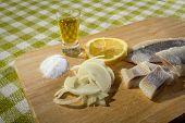stock photo of food chain  - Fillet herring with lemon - JPG