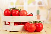 stock photo of wooden crate  - Tomatoes in wooden crate on table in kitchen - JPG