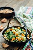 pic of chickpea  - chickpeas and spinach curry on a dark wood background - JPG