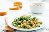 stock photo of chickpea  - chickpeas and spinach curry on a white background - JPG
