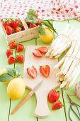 foto of white asparagus  - White asparagus and fresh strawberries in early summer season - JPG