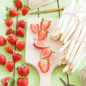 picture of white asparagus  - White asparagus and fresh strawberries in early summer season - JPG
