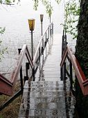 picture of rainy weather  - The footbridge to the lakein rainy weather - JPG